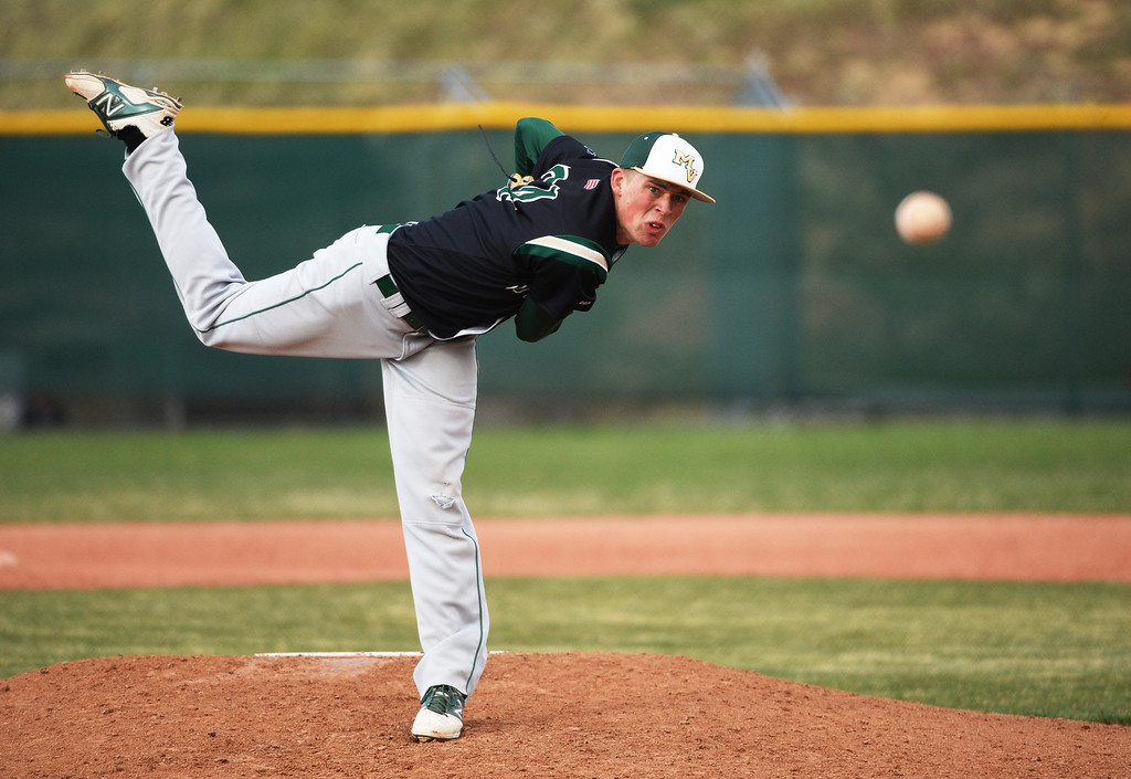 . Nick Leonard of Mountain Vista High School throws out a pitch against Regis Jesuit High School.  (Photo by Hyoung Chang/The Denver Post)