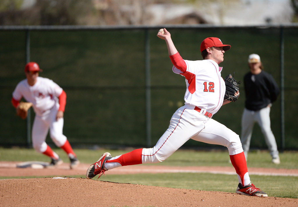 . Brent Schwarz of Regis Jesuit High School (12)  pitches against Mountain Vista High School. Regis won 2-0. (Photo by Hyoung Chang/The Denver Post)