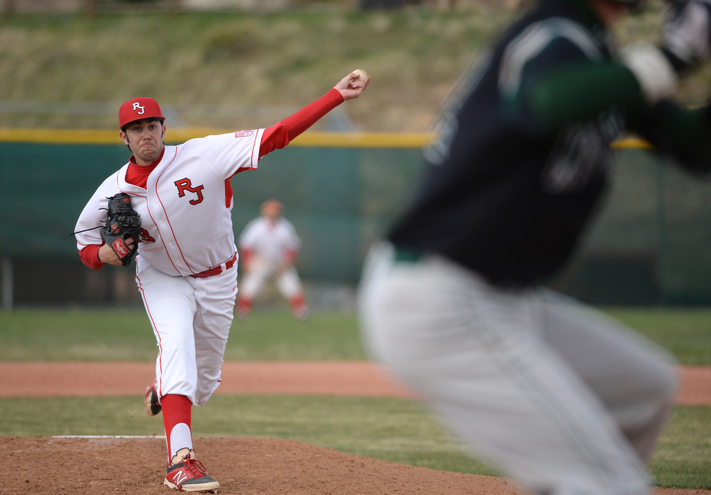 . David Peterson of Regis Jesuit High School pitches against Mountain Vista High School in the 7th inning. (Photo by Hyoung Chang/The Denver Post)