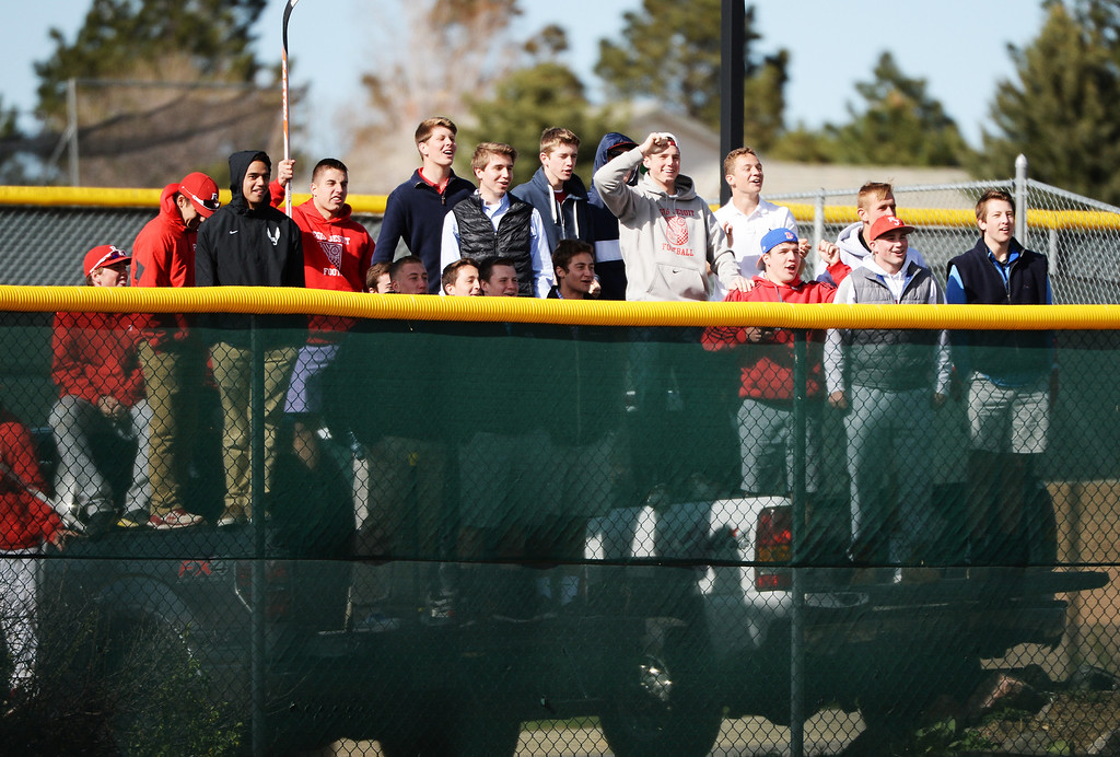 . Regis Jesuit High School students cheer their team during the game against Mountain Vista High School at Regis Jesuit High School in Aurora, Colorado, on Wednesday, April 30, 2014. Regis won 2-0. (Photo by Hyoung Chang/The Denver Post)