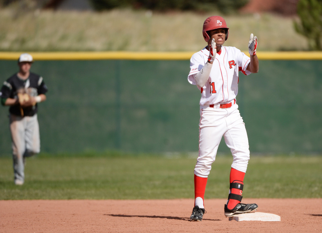 . Quin Cotton of Regis Jesuit High School (11) celebrate his double off of Nick Leonard of Mountain Vista High School (24) in the first inning.  (Photo by Hyoung Chang/The Denver Post)