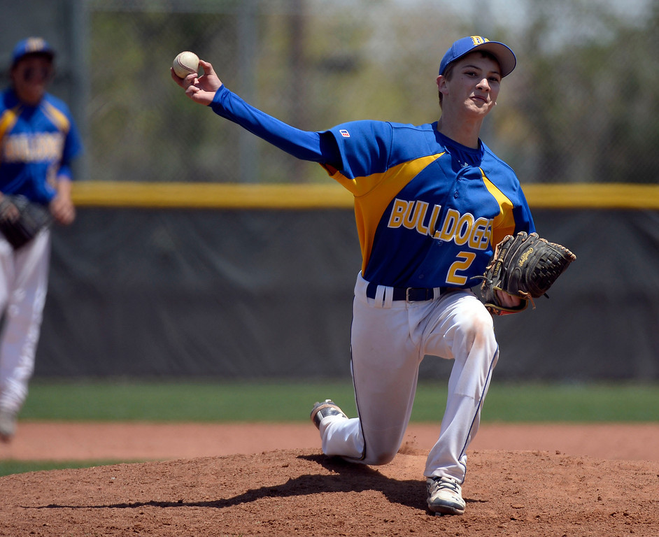 . Dove Creek Colin Hobbs (2) delivers a pitch during the 7th inning in the Championship game May 15, 2014 at All-Star Park. Caliche defeated Dove Creek 17-1 for the title. (Photo by John Leyba/The Denver Post)