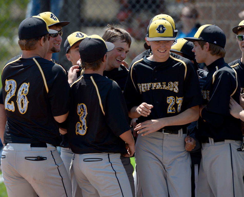 . Caliche Mitch Davison (2) is congratulated by teammates after his round  home run in the 4th inning in the Championship game May 15, 2014 at All-Star Park. Caliche defeated Dove Creek 17-1 for the title. (Photo by John Leyba/The Denver Post)