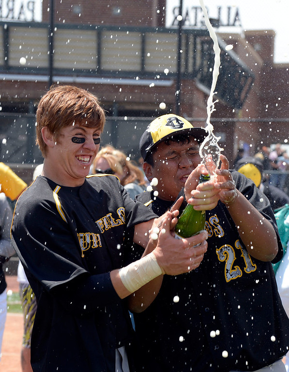 . Caliche Joel Contreras (5) and Tevin Ruiz (21) celebrate the state title over Dove Creek 17-1 in the Championship game May 15, 2014 at All-Star Park. (Photo by John Leyba/The Denver Post)