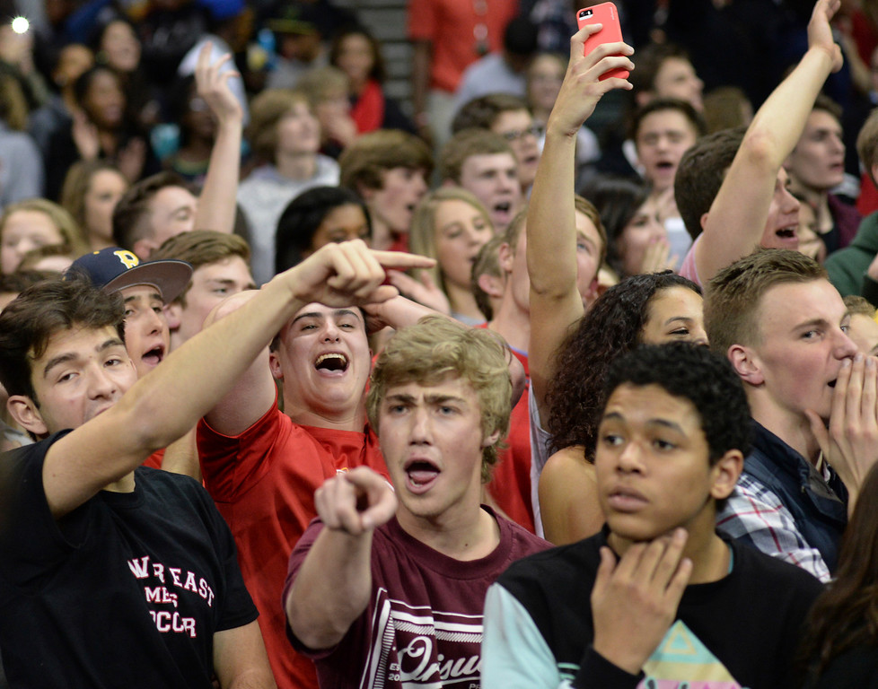 . DENVER, CO - MARCH 7: East students celebrated the win. The Denver East High School boy\'s basketball team defeated Highlands Ranch 64-44 in a 5A quarterfinal playoff game Friday night, March 7, 2014 in Denver, Colorado. (Photo by Karl Gehring/The Denver Post)