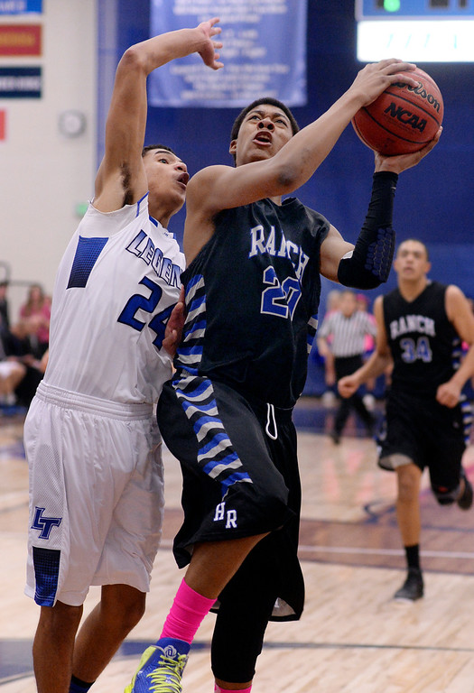 . PARKER, CO. - FEBRUARY 14, 2014: Highlands Ranch forward Keith Coleman (20) looked for a way past Legend defender Elijah Cherrington (24) in the second half. The Highlands Ranch High School boy\'s basketball team defeated Legend 60-46 Friday night February 14, 2104.  Photo By Karl Gehring/The Denver Post