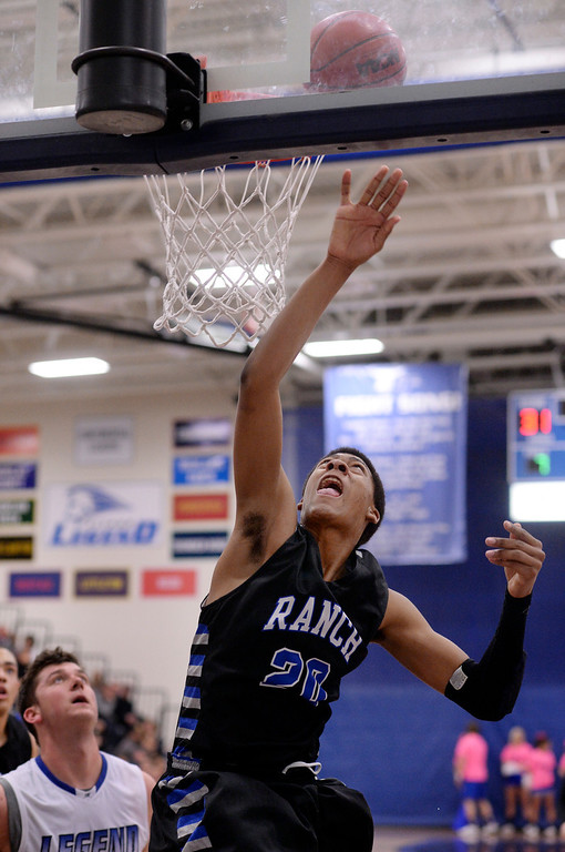 . PARKER, CO. - FEBRUARY 14, 2014: Ranch junior forward Keith Coleman (20) finished a layup in the second half. The Highlands Ranch High School boy\'s basketball team defeated Legend 60-46 Friday night February 14, 2104.  Photo By Karl Gehring/The Denver Post