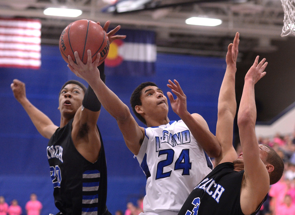. PARKER, CO. - FEBRUARY 14, 2014: Highlands Ranch forward Keith Coleman (20) came up from behind to reject a shot by Legend forward Elijah Cherrignton (24) in the first half. The Legend High School boy\'s basketball team hosted Highlands Ranch Friday night February 14, 2014.  Photo By Karl Gehring/The Denver Post