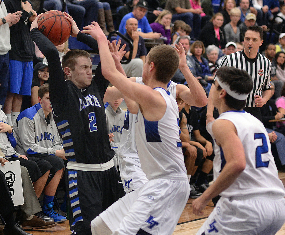 . PARKER, CO. - FEBRUARY 14, 2014: Highlands Ranch guard Patrick Sullivan was trapped on the sideline by Legend defender Monroe Porter (3) in the first half. The Legend High School boy\'s basketball team hosted Highlands Ranch Friday night February 14, 2104.  Photo By Karl Gehring/The Denver Post