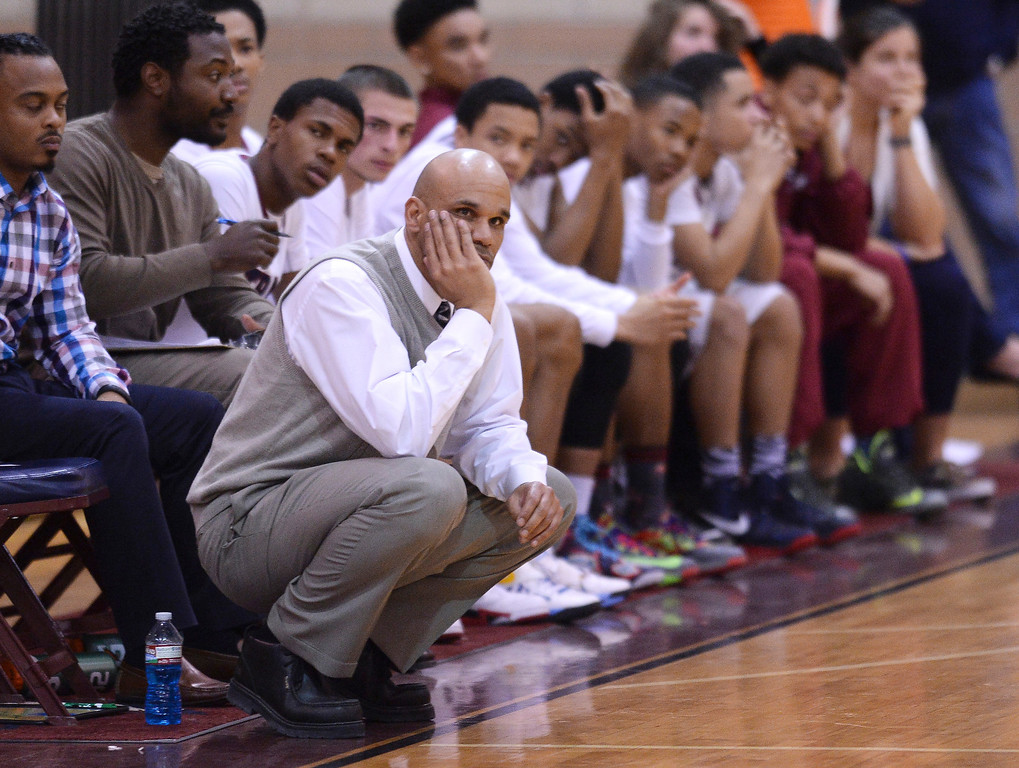 . Cherokee Trail coach Morgan Gregory watched as the Rams built a lead late in the second half. The Rampart High School boy\'s basketball team defeated Cherokee Trail 67-64 Wednesday night, February 26, 2014. Photo By Karl Gehring/The Denver Post