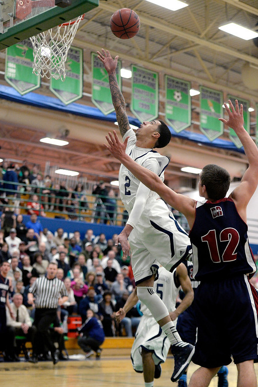 . T�Aren Williams (2) of the Overland Trailblazers makes an easy basket on Jake Flores (12) of the Dakota Ridge Eagles during the first half. (Photo By AAron Ontiveroz/The Denver Post)