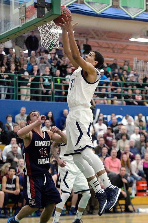 . Ryan Swan (34) of the Overland Trailblazers grabs a rebound over Jake Flores (12) of the Dakota Ridge Eagles during the second half of Overland\'s 67-59 win. (Photo By AAron Ontiveroz/The Denver Post)