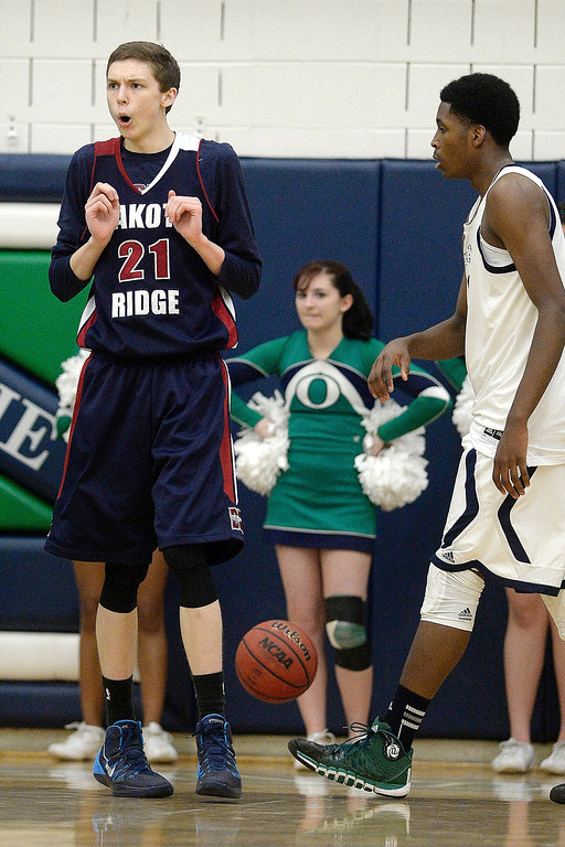 . Ian MacDonald (21) of the Dakota Ridge Eagles reacts to committing a foul on De�Ron Davis (20) of the Overland Trailblazers during the second half. (Photo By AAron Ontiveroz/The Denver Post)