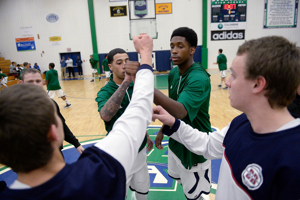 . T�Aren Williams (2) of the Overland Trailblazers and De�Ron Davis (20) bump fists as they meet with the captains from the Dakota Ridge Eagles before the first half. (Photo By AAron Ontiveroz/The Denver Post)