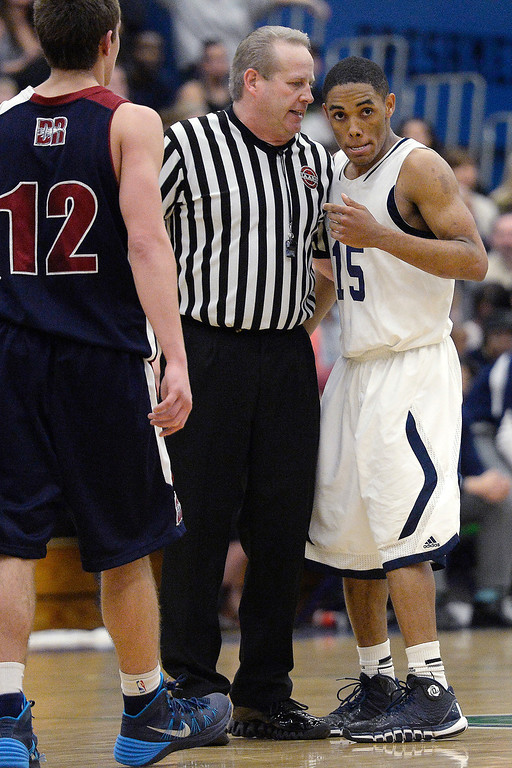 . Austin Conway (15) of the Overland Trailblazers speaks with the referee about a possession call in favor of the Dakota Ridge Eagles during the second half of Overland\'s 67-59 win. (Photo By AAron Ontiveroz/The Denver Post)