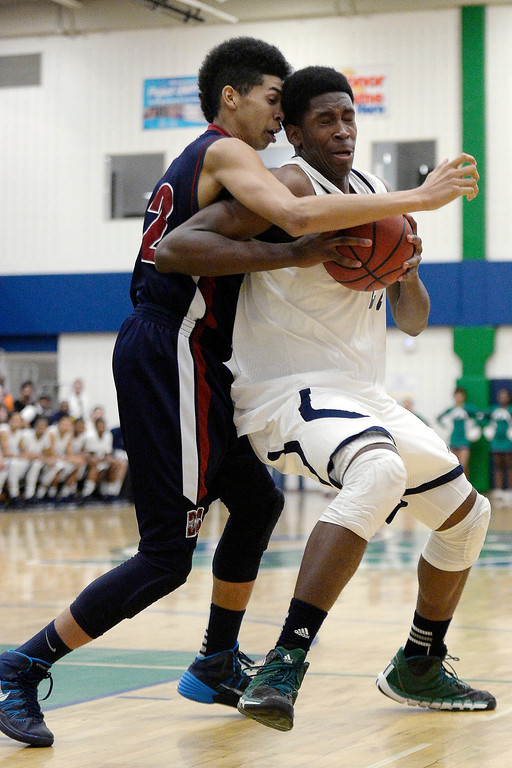 . De�Ron Davis (20) of the Overland Trailblazers drives on Devante Jones (32) of the Dakota Ridge Eagles during the first half. (Photo By AAron Ontiveroz/The Denver Post)