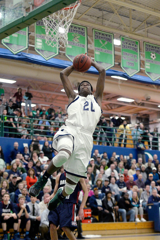. De�Ron Davis (20) of the Overland Trailblazers attempts a dunk against the Dakota Ridge Eagles during the first half. (Photo By AAron Ontiveroz/The Denver Post)