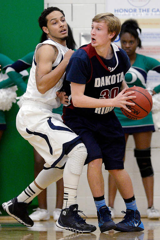 . Khalil Jenkins (13) of the Overland Trailblazers guards Jake Jones (30) of the Dakota Ridge Eagles during the first half. (Photo By AAron Ontiveroz/The Denver Post)