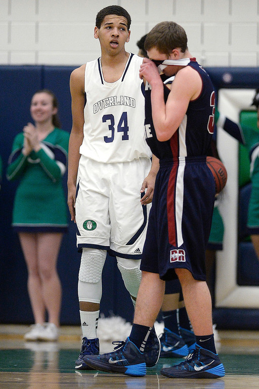 . Cambrian Antrillo (3) of the Dakota Ridge Eagles wipes his face after Ryan Swan (34) of the Overland Trailblazers was fouled during the second half of Overland\'s 67-59 win. (Photo By AAron Ontiveroz/The Denver Post)