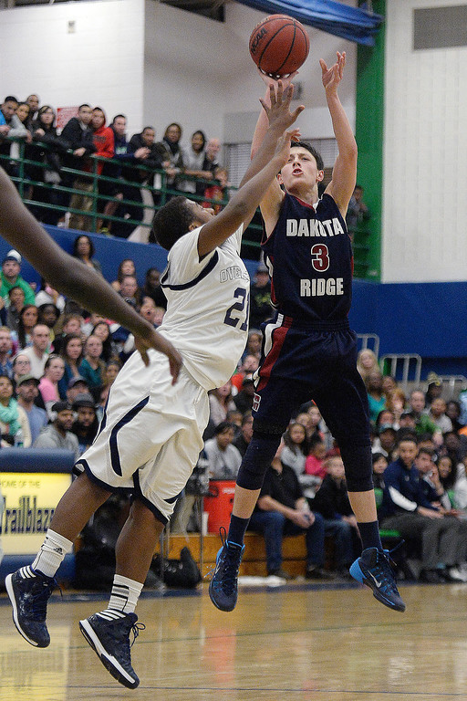 . Cambrian Antrillo (3) of the Dakota Ridge Eagles puts a shot up over Reggie Gibson (21) of the Overland Trailblazers during the second half. (Photo By AAron Ontiveroz/The Denver Post)