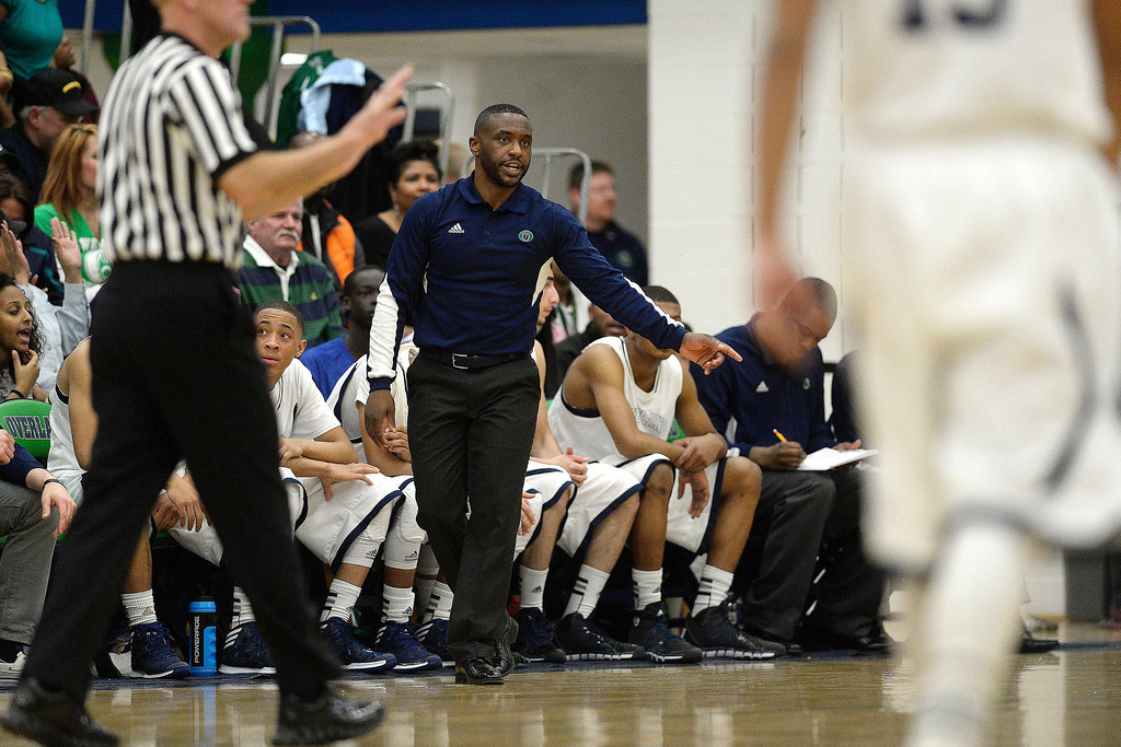 . Head coach Danny Fisher of the Overland Trailblazers calls out instructions against the Dakota Ridge Eagles during the second half of Overland\'s 67-59 win. (Photo By AAron Ontiveroz/The Denver Post)