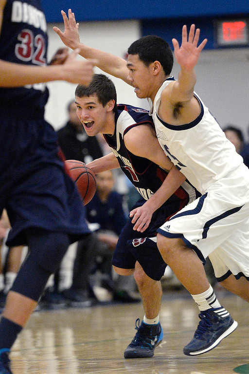 . Cody Pittman (10) of the Dakota Ridge Eagles drives on Tyler Stevenson (25) of the Overland Trailblazers during the second half. (Photo By AAron Ontiveroz/The Denver Post)