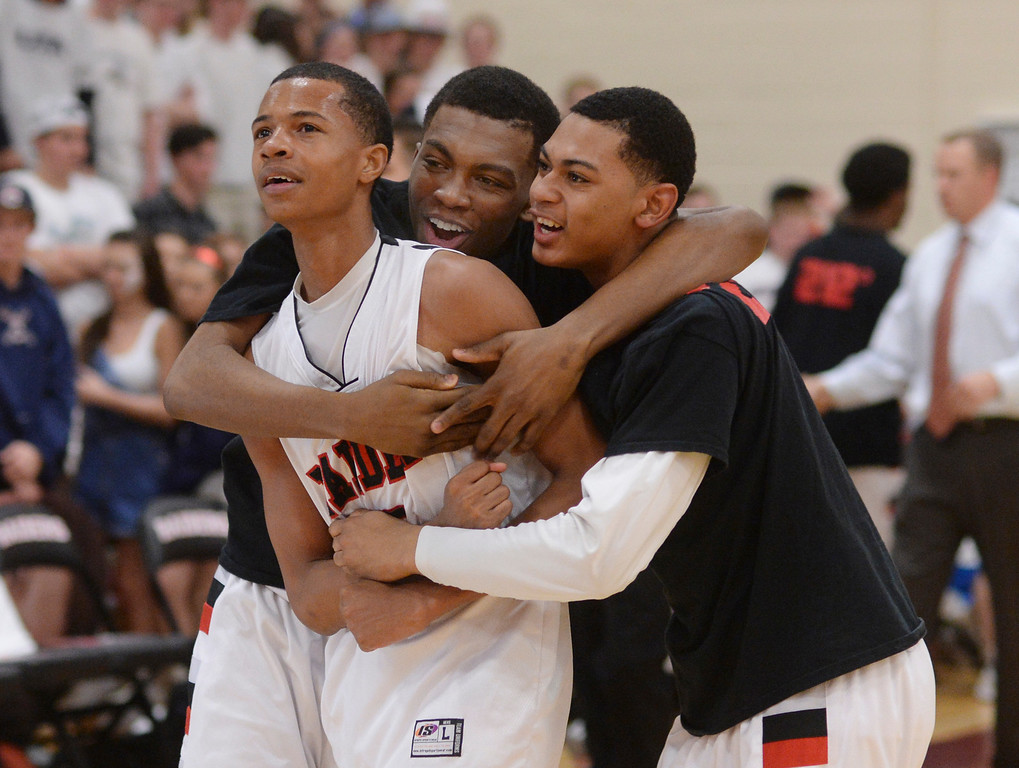 . AURORA, CO. - MARCH 5, 2014: Raiders teammates congratulated sophomore guard Tyrei Randall (5) after the win. The Rangeview High School boy\'s basketball team defeated Chaparral 88-85 in the second overtime period Wednesday night, March 5, 2014. Photo By Karl Gehring/The Denver Post