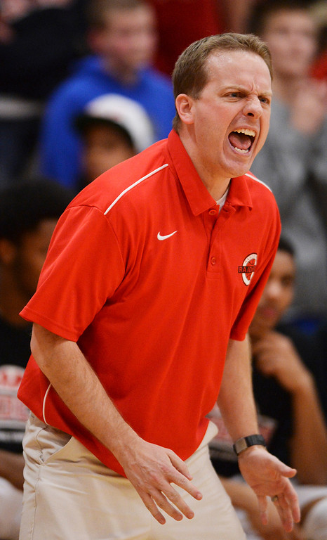 . AURORA, CO. - MARCH 5, 2014: Raiders\' coach Shawn Palmer was animated on the sidelines in the first half. The Rangeview High School boy\'s basketball team defeated Chaparral 88-85 in the second overtime period Wednesday night, March 5, 2014. Photo By Karl Gehring/The Denver Post