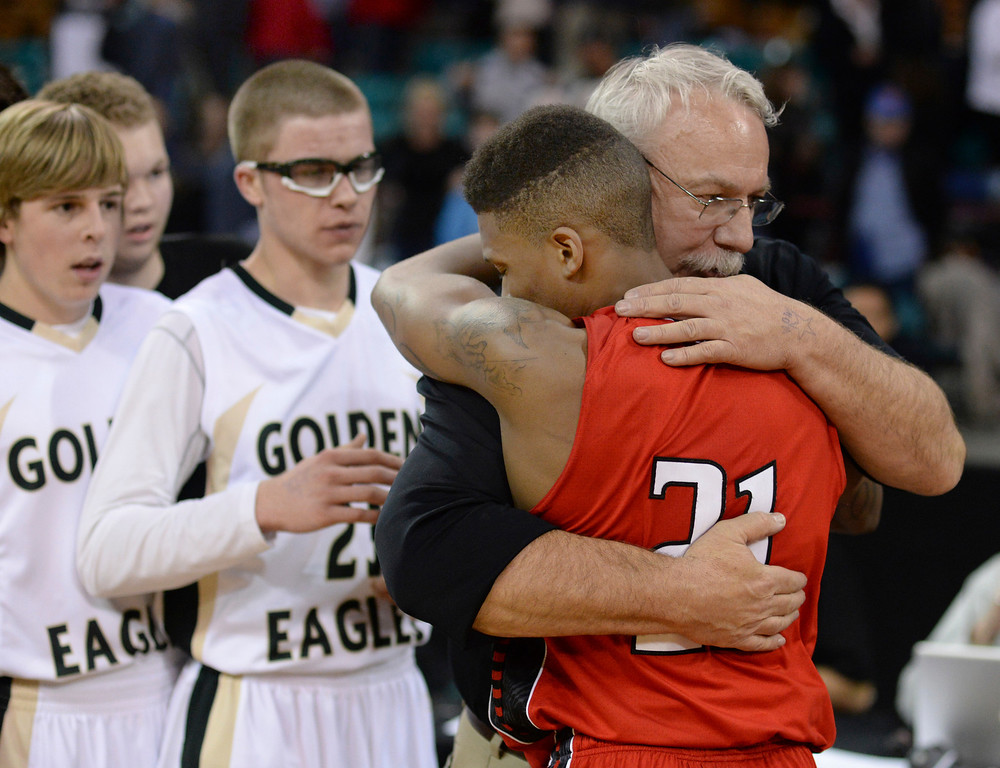 . DENVER, CO - MARCH 7: Mountain Vista coach Bob Wood embraced Eaglecrest senior Jaisean Jackson after the game. The Mountain Vista High School boy\'s basketball team beat Eaglecrest 65-61 in a 5A quarterfinal playoff game Friday night, March 7, 2014 in Denver, Colorado. (Photo by Karl Gehring/The Denver Post)