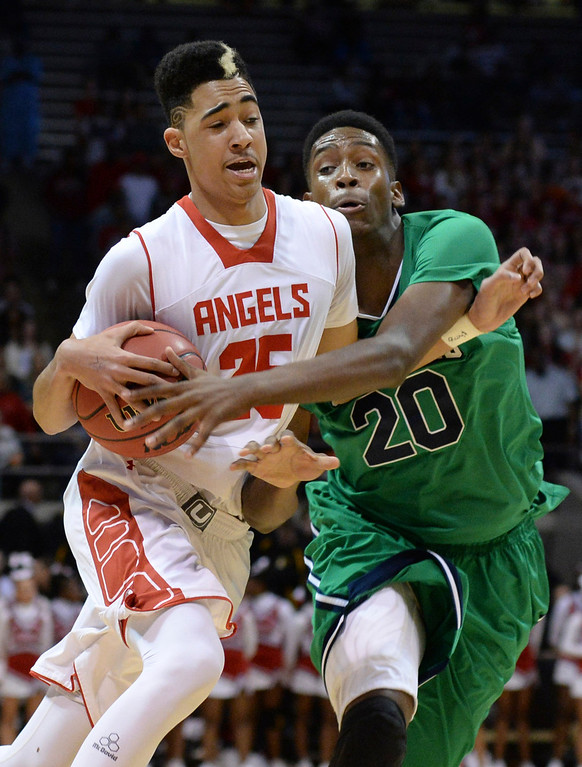 . BOULDER, CO - MARCH 14: Overland center De\'Ron Davis (20) tried to slow down Angels\' forward Ronnie Hurrell (25) in the first half. The Denver East High School boy\'s basketball team matched up against Overland in a 5A semifinal game Friday night, March 14, 2014 in Boulder, Colorado. (Photo by Karl Gehring/The Denver Post)