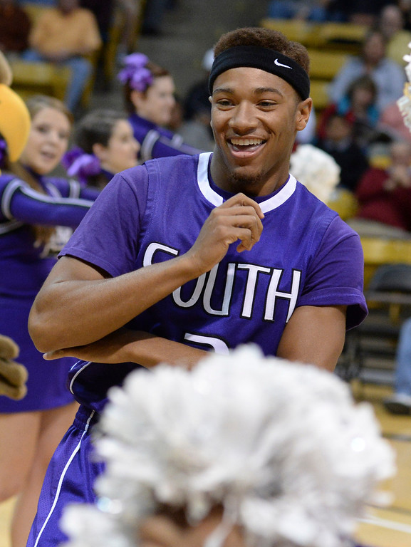 . BOULDER, CO - MARCH 14: Rebels senior guard Shun Jackson (3) smiled during introductions before the game. The Denver South High School boy\'s basketball team took on Cheyenne Mountain in a 4A semifinal game Friday night, March 14, 2014 in Boulder, Colorado. (Photo by Karl Gehring/The Denver Post)