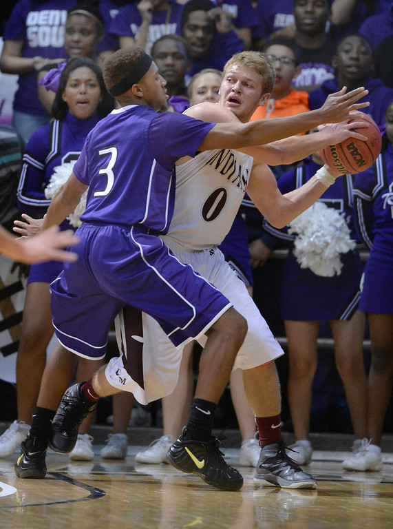 . BOULDER, CO - MARCH 14: Denver South guard Shun Jackson (3) had Indians\' junior Christian Nehme  (0) trapped in the corner during the first half. The Denver South High School boy\'s basketball team took on Cheyenne Mountain in a 4A semifinal game Friday night, March 14, 2014 in Boulder, Colorado. (Photo by Karl Gehring/The Denver Post)