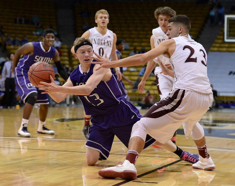 . BOULDER, CO - MARCH 14: Denver South junior guard Turner Dumas Peterson (13) went to the floor to grab a loose ball in the first half. The Denver South High School boy\'s basketball team took on Cheyenne Mountain in a 4A semifinal game Friday night, March 14, 2014 in Boulder, Colorado. (Photo by Karl Gehring/The Denver Post)