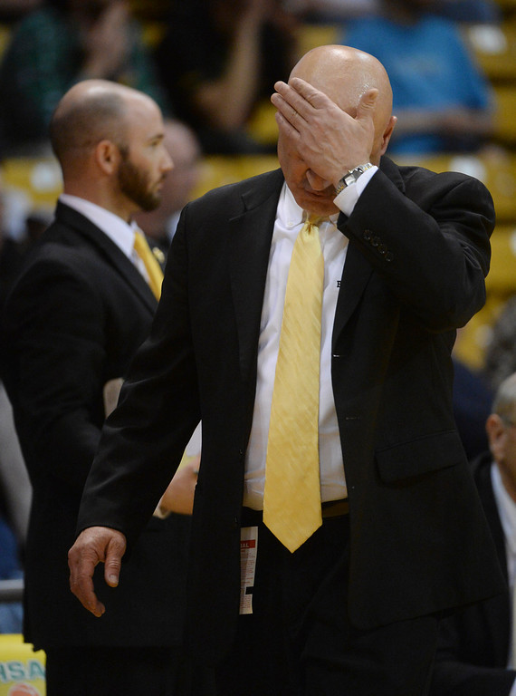 . BOULDER, CO - MARCH 14: Pueblo East coach Dave Rydar felt the heat in the first half. The Pueblo East High School boy\'s basketball team took on Sand Creek in a 4A semifinal game Friday night, March 14, 2014 in Boulder, Colorado. (Photo by Karl Gehring/The Denver Post)