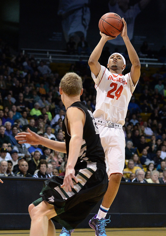 . BOULDER, CO - MARCH15: Denver East guard Dom Collier drained a shot from outside in the second half. The Denver East High School boy\'s basketball team took on Fossil Ridge in the 5A championship game Saturday night, March 15, 2014 in Boulder, Colorado. (Photo by Karl Gehring/The Denver Post)