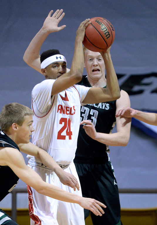 . BOULDER, CO - MARCH15: SaberCats\' post Matt Laine (33) guarded Dom Collier (24) in the first half. The Denver East High School boy\'s basketball team took on Fossil Ridge in the 5A championship game Saturday night, March 15, 2014 in Boulder, Colorado. (Photo by Karl Gehring/The Denver Post)