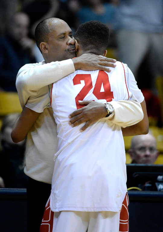 . BOULDER, CO - MARCH15: East coach Rudy Carey embraced senior Dominique Collier after he played his final minutes as an Angel. The Denver East High School boy\'s basketball team took the 5A championship game with a 70-49 win over Fossil Ridge Saturday night, March 15, 2014 in Boulder, Colorado. (Photo by Karl Gehring/The Denver Post)