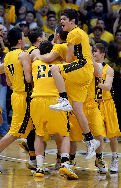 . BOULDER, CO - MARCH15: The Pueblo East High School boy\'s basketball team took the 4A state title with a 58-51 win over Denver South in the championship game Saturday night, March 15, 2014 in Boulder, Colorado. (Photo by Karl Gehring/The Denver Post)
