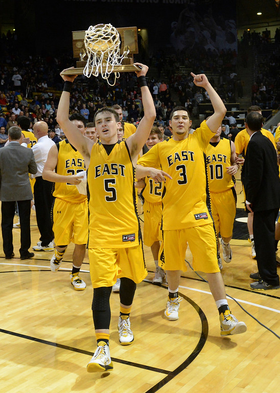 . BOULDER, CO - MARCH15: Pueblo East guard TJ Gradisar brought the trophy over for the fans to enjoy. The Pueblo East High School boy\'s basketball team took the 4A state title with a 58-51 win over Denver South in the championship game Saturday night, March 15, 2014 in Boulder, Colorado. (Photo by Karl Gehring/The Denver Post)