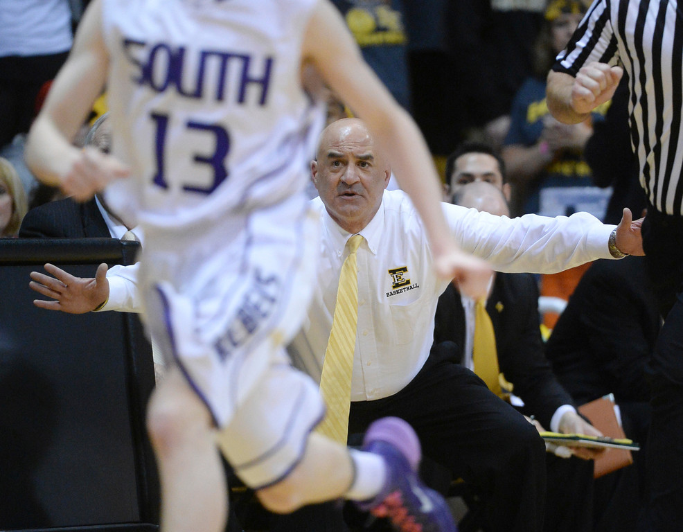 . BOULDER, CO - MARCH15: Pueblo East coach Dave Ryder watched from the bench in the final minutes. The Pueblo East High School boy\'s basketball team took the 4A state title with a 58-51 win over Denver South in the championship game Saturday night, March 15, 2014 in Boulder, Colorado. (Photo by Karl Gehring/The Denver Post)