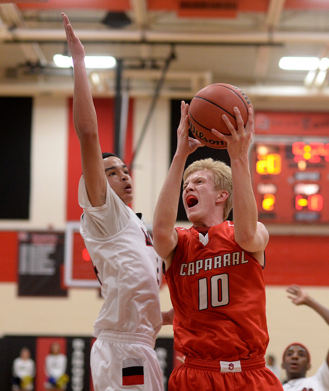. Chaparral junior forward Jake Holtzmann (10) drove to the basket against Rangeview defender Tarren Storey-Way (24) in the first half. The Rangeview High School boy\'s basketball team hosted Chaparral Wednesday night, March 5, 2014. Photo By Karl Gehring/The Denver Post