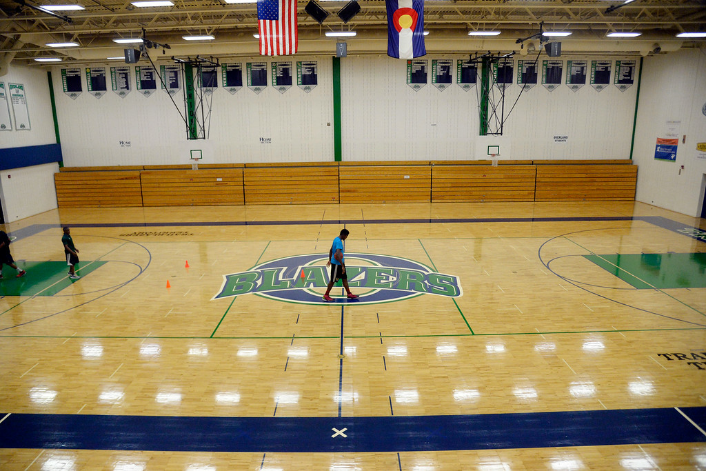 . AURORA, CO - JULY 29: De\'Ron Davis, who was excited upon being the first player to walk on the new Overland High School court, takes a breather as he and teammate King Grant-Perry are put through a grueling offseason workout by head coach Danny Fisher. De\'Ron Davis was photographed on Wednesday, July 29, 2014. (Photo by AAron Ontiveroz/The Denver Post)