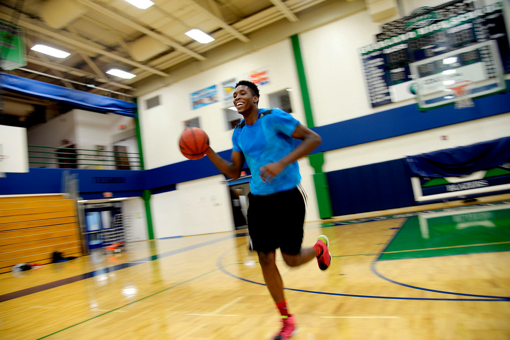 . AURORA, CO - JULY 29: De\'Ron Davis laughs as he breathes hard while dribbling loops during a tough offseason workout with teammate Kingahnah Grant-Perry and coach Danny Fisher. De\'Ron Davis was photographed on Wednesday, July 29, 2014. (Photo by AAron Ontiveroz/The Denver Post)