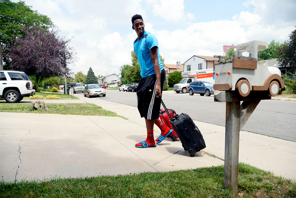 . AURORA, CO - JULY 29: De\'Ron Davis, at 6-10, barely fits through doorways and must bend slightly to use a roller bag. De\'Ron Davis was photographed on Wednesday, July 29, 2014. (Photo by AAron Ontiveroz/The Denver Post)