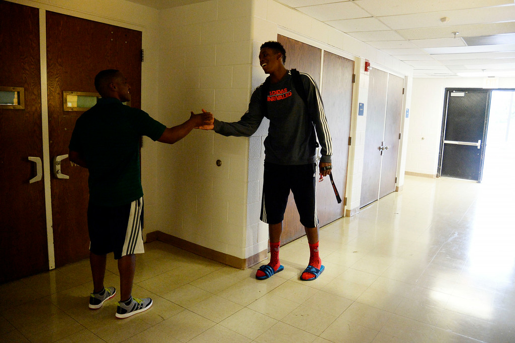 . AURORA, CO - JULY 29: De\'Ron Davis and coach Danny Fisher shake hands as they part ways following an offseason workout. De\'Ron Davis was photographed on Wednesday, July 29, 2014. (Photo by AAron Ontiveroz/The Denver Post)