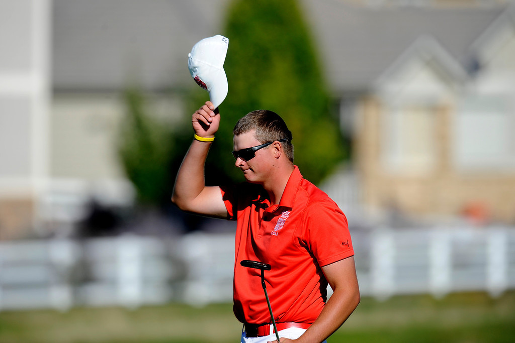 . AURORA, CO: Oct. 1, 2013  5A champion Spencer Painton tips his hat after sinking his final putt of the day.   (Photo By Erin Hull/The Denver Post)