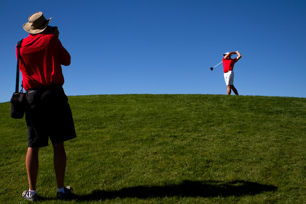 . AURORA, CO: Oct. 1, 2013  Tim Painton take a photo of his son, Spencer, as he tees off on the first hole during the final round of the 5A state golf tournament at Murphy Creek Golf Course.  (Photo By Erin Hull/The Denver Post)