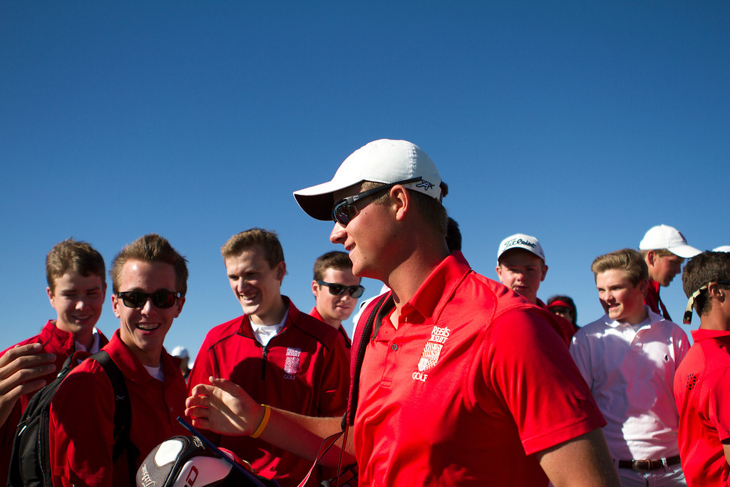 . AURORA, CO: Oct. 1, 2013  Spencer Painton of Regis Jesuit High School is congratulated by friends and teammates after sinking his last put of the day. Painton finished 6 under par and was the 5A champion.   (Photo By Erin Hull/The Denver Post)