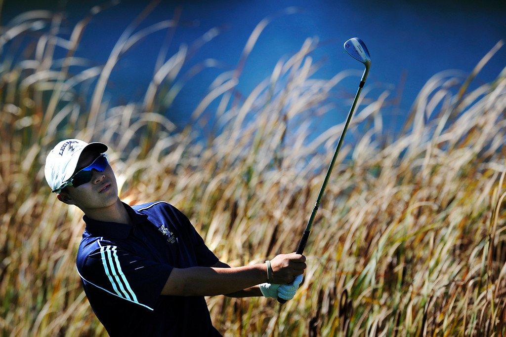 . AURORA, CO: Oct. 1, 2013  Li Chen watch after a shot as he competes in the final round of the 5A state golf tournament. He would go on to tie for second.   (Photo By Erin Hull/The Denver Post)