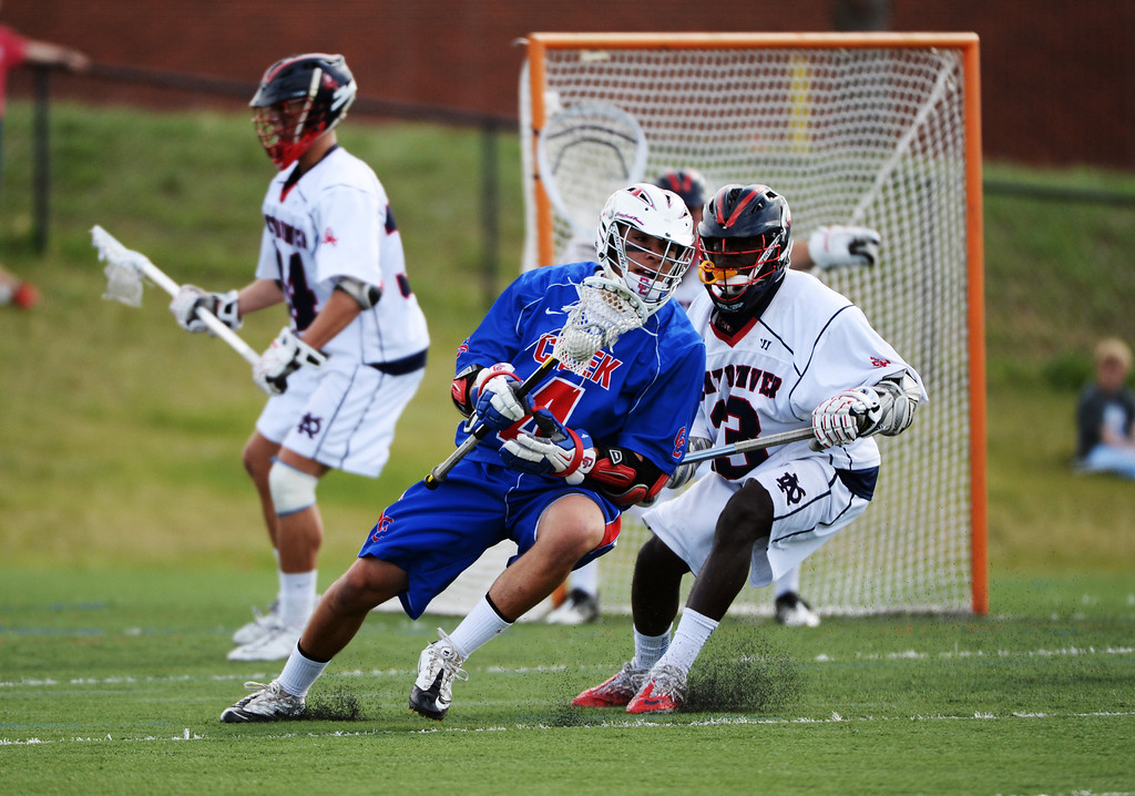 . ENGLEWOOD MAY 02: Tristan Snellgrove of Cherry Creek High School (4) controls the ball under the pressure of Trevon Hamlet of Kent Denver High School (3). Englewood, Colorado May 2, 2014. (Photo by Hyoung Chang/The Denver Post)